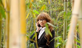 Beautiful asian woman using smart phone. In the park Stock Image