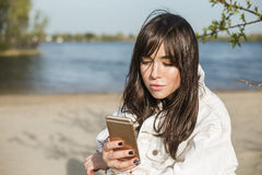 Beautiful asian woman using smart phone. People and technology concept Stock Photos