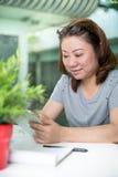 Beautiful asian woman using tablet computer Stock Photos