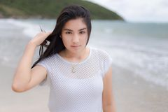 Beautiful Asian woman vacation on beach of Thailand Royalty Free Stock Photos