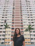 A beautiful asian woman with the vintage style pastel colors building in Hong Kong stock photos