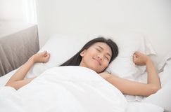 Beautiful Asian woman waking up Stock Images