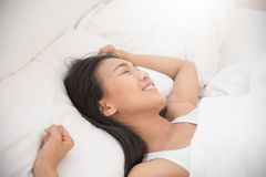 Beautiful Asian woman waking up in the morning. Stock Photos
