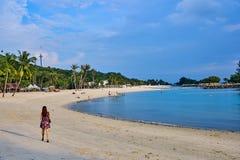 Beautiful asian woman walking on the Siloso Beach at Singapore stock photos