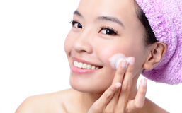 Beautiful asian woman washing her beauty face. With cleansing foam on her hands, isolated on white background Royalty Free Stock Photography
