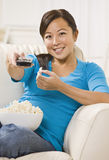 Beautiful Asian Woman Watching T.V. Royalty Free Stock Photos