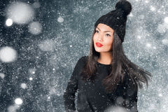 Beautiful asian woman wearing knitted hat with pompom. In a snow Royalty Free Stock Photography