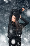 Beautiful asian woman wearing knitted hat with pompom. In a snow Stock Photo
