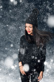 Beautiful asian woman wearing knitted hat with pompom. In a snow Royalty Free Stock Photo