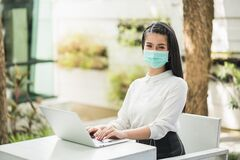 Free Beautiful Asian Woman Wearing Protection Mask Work From Home In The Morning. Young Asian Female With Laptop Stay At Home Royalty Free Stock Photos - 188706328