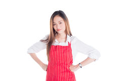 Beautiful asian woman wearing red apron and looking at camera Stock Photo