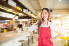 Beautiful Asian Woman Wearing Red Apron Smiling Royalty Free Stock Photo