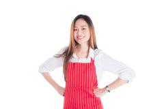 Beautiful asian woman wearing red apron smiling Stock Photos