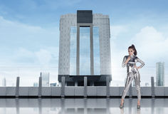 Beautiful asian woman wearing silver latex suit standing on the Royalty Free Stock Image