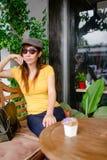 Beautiful Asian woman wearing sunglasses Stock Photo