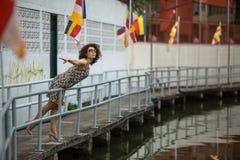 Beautiful  asian woman wearing sunglasses on the river embankment. Beautiful young asian woman wearing sunglasses on the river embankment Royalty Free Stock Photos