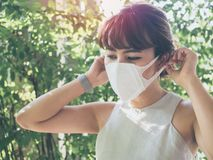 Beautiful asian woman wearing white protective N95 mask stock photos