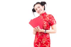 Beautiful asian woman wears cheongsam on white background. Holding red envelopes and smile in chinese new year.  Stock Photo