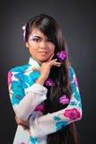 Beautiful asian woman wears a national dress Stock Photography