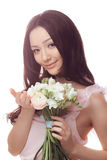 Beautiful asian woman in white dress with bouquet of flowers in hands royalty free stock photos