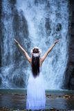 Beautiful Asian woman with white traditional dress explore at wa Royalty Free Stock Images