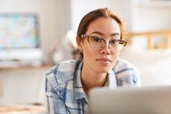Beautiful Asian Woman Working from Home royalty free stock photo