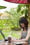 Beautiful Asian woman writing. Stock Images