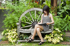 Beautiful Asian woman writing. Royalty Free Stock Photos