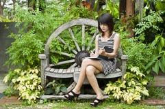 Beautiful Asian woman writing. Royalty Free Stock Image