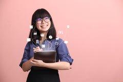 Beautiful Asian woman writing information stock photo