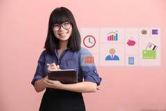 Beautiful Asian woman writing information royalty free stock photos