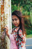 Beautiful Asian woman, Young Asian girl portrait smiling. summer hiking in the mountain park tagaytay Philippines Royalty Free Stock Photo