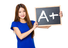 Beautiful asian women asian hold wood blackboard showing A plus Royalty Free Stock Images