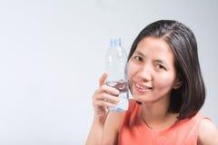 Beautiful Asian women and Bottled water Stock Photos