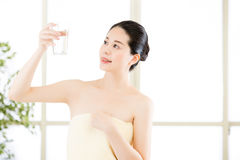 Beautiful asian women drinking water with smile face after showe Royalty Free Stock Photos