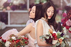 Beautiful asian women florists with bouquet of flowers in flower store Royalty Free Stock Photography