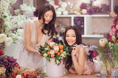 Beautiful asian women florists with bouquet of flowers in flower store Royalty Free Stock Photo