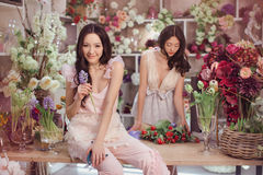 Beautiful asian women florists happy working in flower store with a lot of spring flowers Stock Photo