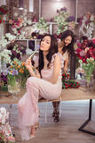 Beautiful asian women florists working in flower store with a lot of spring flowers Stock Image