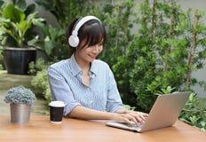 Beautiful Asian women Listen to music stock image