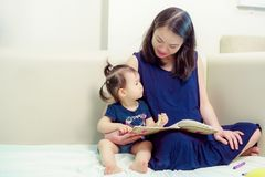 beautiful Asian woman is pregnant. Wearing a blue dress Living together, daughter stock image