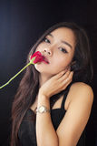 Beautiful asian women and red rose on black background Royalty Free Stock Photos