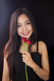 Beautiful asian women and red rose on black background Royalty Free Stock Photography
