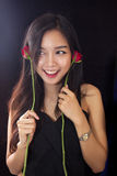 Beautiful asian women and red rose on black background Stock Photo