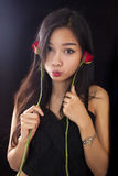 Beautiful asian women and red rose on black background Royalty Free Stock Images