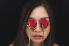 Beautiful asian women and red rose on black background Stock Image