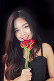Beautiful asian women and red rose on black background Stock Images