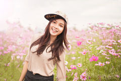 Beautiful asian women smiling in pink cosmos flower field Royalty Free Stock Photography