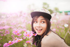 Beautiful asian women smiling in pink cosmos flower field Royalty Free Stock Photo