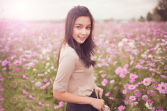 Beautiful asian women smiling in pink cosmos flower field Royalty Free Stock Images